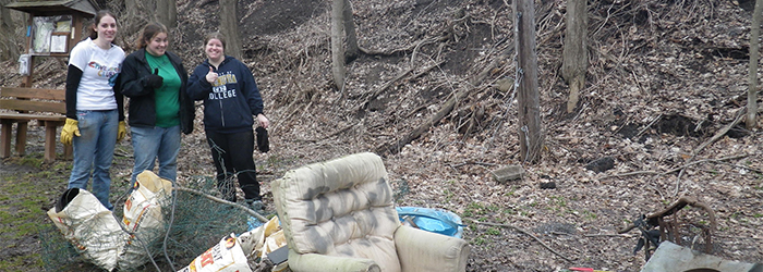 Caz College students cleaning up Chittenango Creek