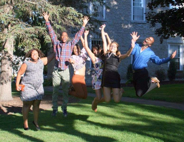 HEOP students jumping for joy