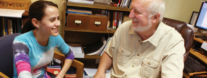 Cazenovia student studying coursework with professor