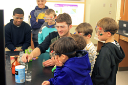 Cazenovia College students with community members during Science Is Fun event at the College