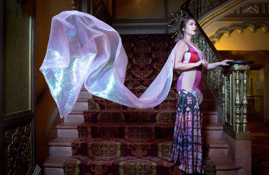 Fashion student on a staircase displaying a shawl