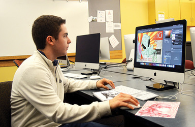 Male student at work on a computer illustration
